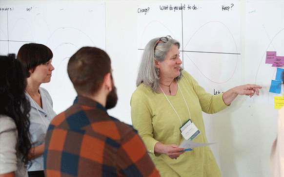 Researchers at whiteboard